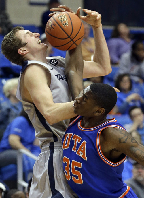 Utah State forward Ben Clifford (1) and Texas-Arlington forward Brandon Edwards (35) fight for control of the ball during the first half of an NCAA basketball game, Saturday, March 2, 2013, in Arlington, Texas. (AP Photo/LM Otero)