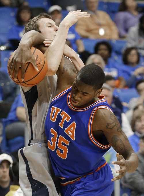 Texas-Arlington forward Brandon Edwards (35) takes the ball from Utah State forward Ben Clifford during the first half of an NCAA college basketball game Saturday, March 2, 2013, in Arlington, Texas. (AP Photo/LM Otero)