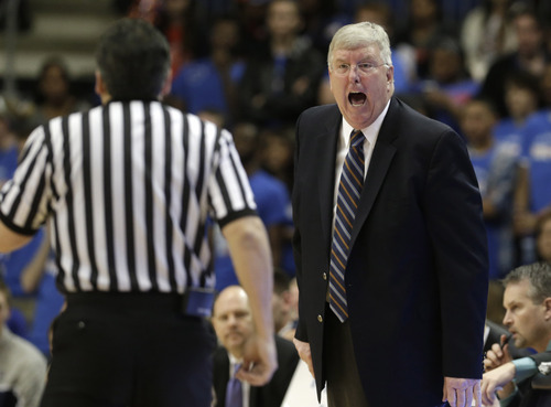 Utah State head coach Stew Morrill, right,  yells at a referee during the first half of an NCAA college basketball game against Texas-Arlington, Saturday, March 2, 2013, in Arlington, Texas. (AP Photo/LM Otero)