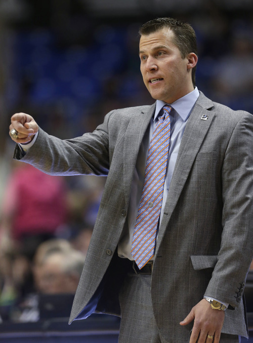 Texas-Arlington coach Scott Cross points from the sideline during the first half of an NCAA college basketball game against Utah State, Saturday, March 2, 2013, in Arlington, Texas. (AP Photo/LM Otero)