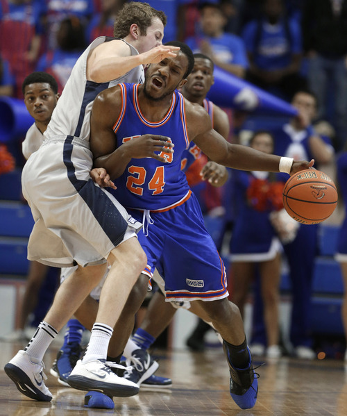 Texas-Arlington forward Kevin Butler (24) drives against Utah State forward Ben Clifford during the first half of an NCAA college basketball game, Saturday, March 2, 2013, in Arlington, Texas. (AP Photo/LM Otero)