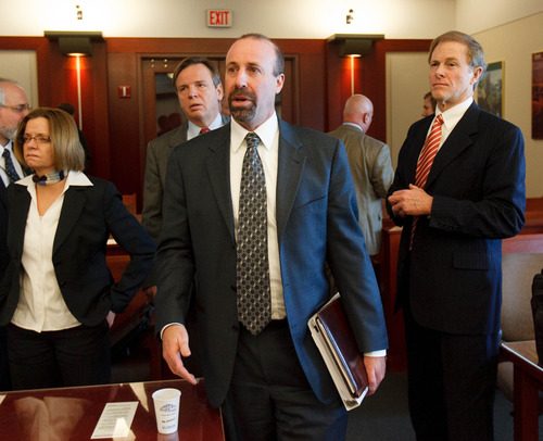 Trent Nelson  |  The Salt Lake Tribune Assistant Attorneys General Joni Jones and David Wolf, and attorney Jeffrey Shields after a court hearing concerning Utah's management of the United Effort Plan Friday, February 15, 2013 in Salt Lake City. At rear left is attorney Mark Callister.