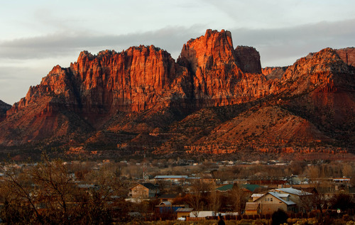 Trent Nelson  |  The Salt Lake Tribune The sun sets on the community of Colorado City, Arizona and Hildale, Utah Thursday November 29, 2012.