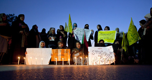 Pakistani Shiite Muslim women light candles during a demonstration to condemn Sunday's car bombing that killed dozens of people, in Islamabad, Pakistan, Monday, March 4, 2013. Shiite Muslims in the Southern Pakistani city Karachi demanded government protection from a wave of violence that has targeted the minority sect, a day after a massive bombing in the city killed scores of people. (AP Photo/Anjum Naveed)