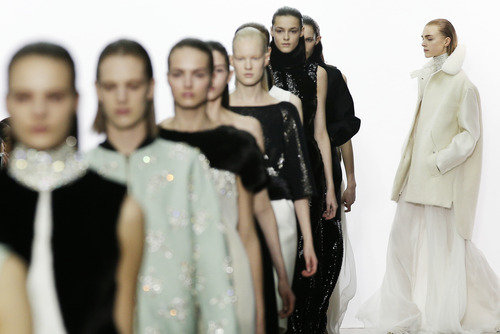 Models wear creations by fashion designer Giambattista Valli for his Fall/Winter 2013-2014 ready to wear collection, in Paris, Monday, March, 4, 2013. (AP Photo/Christophe Ena)