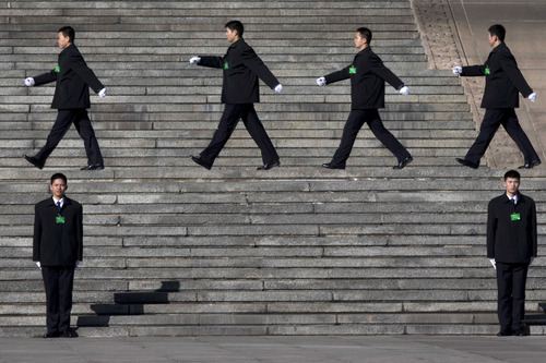 Chinese security personnel march outside the Great Hall of the People in Beijing, China, Monday, March 4, 2013.  In a rare move, China on Monday declined to reveal its defense budget request for 2013. It has been customarily that the country announces its defense spending plan for a new year at a press conference that is held a day before the opening of an annual session of the National People's Congress, China's parliament. (AP Photo/Ng Han Guan)