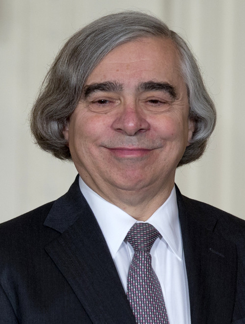 MIT physics professor Ernest Moniz smiles as he stands on stage in the East Room of the White House in Washington, Monday, March 4, 2013, where President Barack Obama announces he would nominate Moniz for Energy Secretary . (AP Photo/Carolyn Kaster)