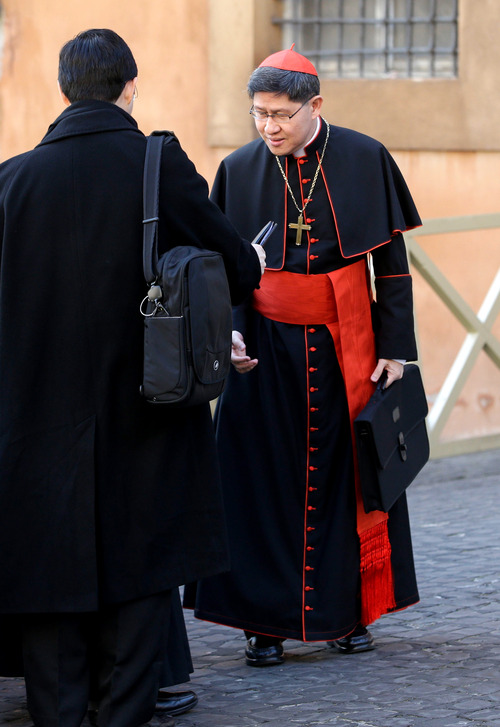 Cardinal Luis Antonio Tagle, of the Philippines, right, arrives for a meeting, at the Vatican, Monday, March 4, 2013. Cardinals from around the world have gathered inside the Vatican for their first round of meetings before the conclave to elect the next pope, amid scandals inside and out of the Vatican and the continued reverberations of Benedict XVI's decision to retire. (AP Photo/Andrew Medichini)
