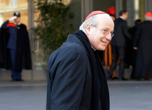 Austrian Cardinal Christoph Schoenborn smiles as he arrives for a meeting, at the Vatican, Monday, March 4, 2013. Cardinals from around the world have gathered inside the Vatican for their first round of meetings before the conclave to elect the next pope, amid scandals inside and out of the Vatican and the continued reverberations of Benedict XVI's decision to retire. (AP Photo/Andrew Medichini)
