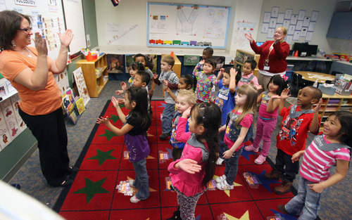 Steve Griffin | The Salt Lake Tribune Alison Ovard, right, and Heather Grimes sing with Ovard's afternoon preschool class on Monday at Woodrow Wilson Elementary in the Granite School District in Salt Lake City. SB71, a bill to create a preschool program for at-risk kids, is based on Granite's program.