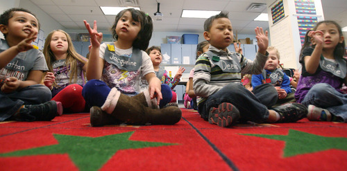 Steve Griffin | The Salt Lake Tribune Students in Alison Ovard's afternoon preschool class at Woodrow Wilson Elementary in the Granite School District in Salt Lake City sing with their teachers on Monday. SB71, a bill to create a preschool program for at-risk kids, is based on Granite's program.