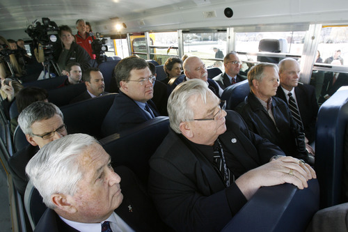Francisco Kjolseth  |  The Salt Lake Tribune State representatives, community leaders and the press pack themselves into a CNG school bus to hear Governor Gary R. Herbert make an announcement on Monday, March 4, 2013 at the capitol. The governor re-affirmed his call for state and local government, schools, public transit, businesses and industry to transition more of their fleet to clean fuel vehicles, as bill SB275 initiates a process to target heavy vehicle and fleet emissions.