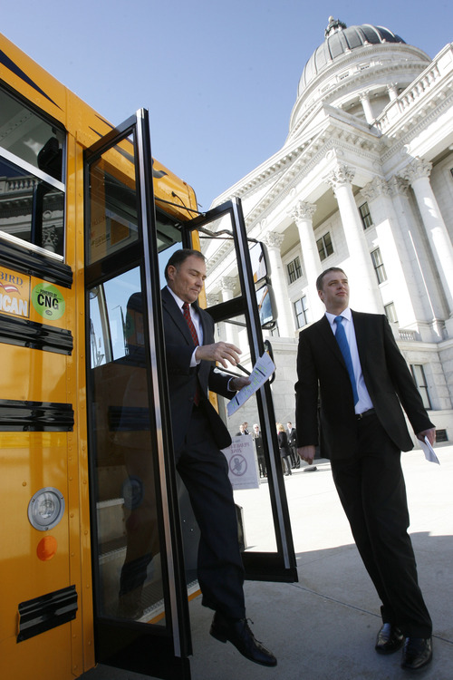 Francisco Kjolseth  |  The Salt Lake Tribune Governor Gary R. Herbert exits a packed CNG bus full of state representatives and the press parked next to the capitol on Monday, March 4, 2013 following an announcement. The governor re-affirmed his call for state and local government, schools, public transit, businesses and industry to transition more of their fleet to clean fuel vehicles, as bill SB275 initiates a process to target heavy vehicle and fleet emissions.