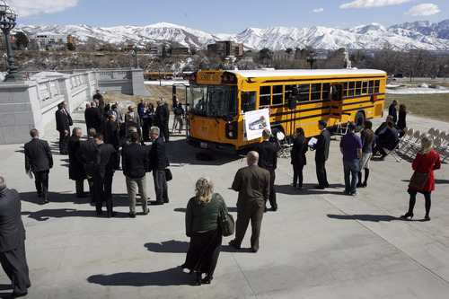 Francisco Kjolseth  |  The Salt Lake Tribune Crowds gather as they await the arrival of Gov. Gary R. Herbert before packing himself, legislators and the press into a CNG school bus parked next to the Capitol on Monday, March 4, 2013 for an announcement. The governor re-affirmed his call for state and local government, schools, public transit, businesses and industry to transition more of their fleet to clean fuel vehicles, as bill SB275 initiates a process to target heavy vehicle and fleet emissions.