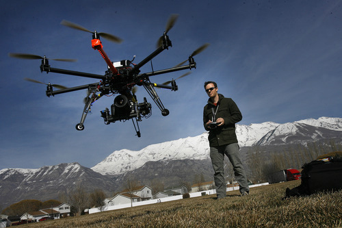 Scott Sommerdorf   |  The Salt Lake Tribune Chris Newman, owner of Cinechopper, flies a remote controlled drone for shooting aerial photography at a park near his home in Lindon, Saturday, March 2, 2013.