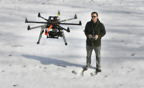 Scott Sommerdorf   |  The Salt Lake Tribune Chris Newman, owner of Cinechopper, flies a remote controlled drone for shooting aerial photography, Saturday, March 2, 2013.