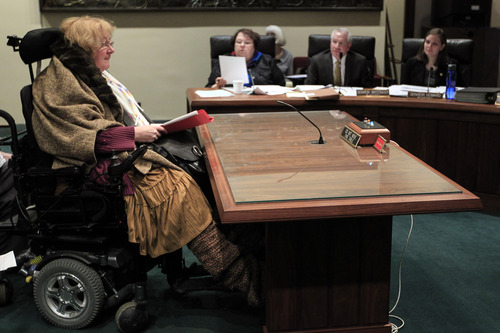Kathy Hoell testifies before the Health and Human Services Committee in Lincoln, Neb., Thursday, Feb. 28, 2013, in favor of a proposal to expand Medicaid in Nebraska. (AP Photo/Nati Harnik)