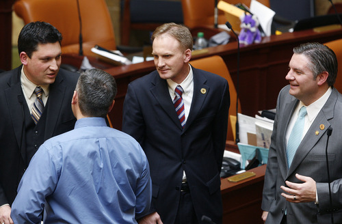 Scott Sommerdorf   |  The Salt Lake Tribune Rep. Craig Hall, R-West Valley City, who replaced longtime Democratic Rep. Neal Hendrickson, speaks with other representatives after the Thursday session adjourned, Thursday, February 21, 2013. At the far left is Rep. Ryan Wilcox, R-Ogden, left foreground is Rep. Daniel McCay, R-Riverton, and Rep. John Knotwell, R-Herriman at the far right.