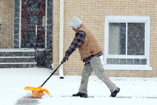Heavy snow fall is keeping area residents busy clearing sidewalks Tuesday March 5, 2013 in LaPorte, Ind. (AP Photo/LaPorte Herald Argus, Bob Wellinski)