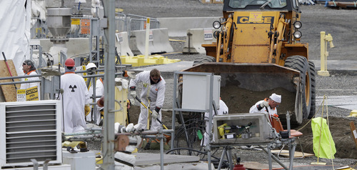 Workers labor at the 'C' Tank Farm at the Hanford Nuclear Reservation, Wednesday, March 6, 2013, near Richland, Wash. Washington Gov. Jay Inslee was at Hanford Wednesday to meet with Dept. of Energy officials in order to learn more about tanks on the site that are leaking radioactive waste. (AP Photo/Ted S. Warren)