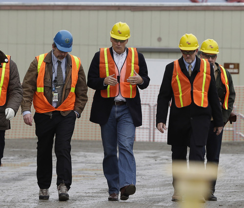Washington Gov. Jay Inslee, second from left, walks with other officials, Wednesday, March 6, 2013, as he tours the Hanford Nuclear Reservation near Richland, Wash. Inslee was at Hanford to meet with Dept. of Energy officials in order to learn more about tanks on the site that are leaking radioactive waste. (AP Photo/Ted S. Warren)