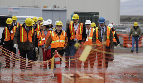 Washington Gov. Jay Inslee, third from right, walks with other officials, Wednesday, March 6, 2013, as he tours the Hanford Nuclear Reservation near Richland, Wash. Inslee was at Hanford to meet with Dept. of Energy officials in order to learn more about tanks on the site that are leaking radioactive waste. (AP Photo/Ted S. Warren)