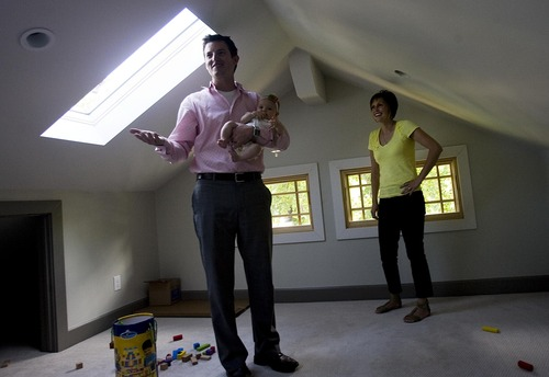 Djamila Grossman  |  The Salt Lake Tribune  Marty and Jessica Patch and their daughter Penelope, 4 months,  talk about their energy-efficient home in Salt Lake City, Utah, on Thursday, Aug. 4, 2011. The family won the Rocky Mountain Power WattSmart video contest.