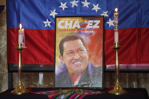 An image of Venezuela's late President Hugo Chavez sits on display at a chapel inside Congress in La Paz, Bolivia, Wednesday, March 6, 2013. Chavez, who died Tuesday at age 58, was seen as a hero by some for his socialist programs, his anti-U.S. rhetoric and gifts of cut-rate oil. Others considered him a bully who repressed his opponents. (AP Photo/Juan Karita)