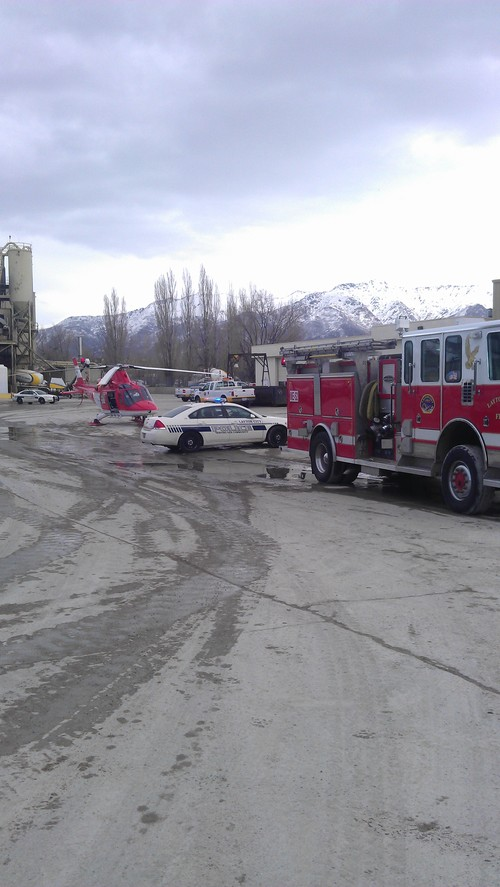 Courtesy photo Crews respond to an industrial accident in Layton on Wednesday where a man was reportedly stuck in an auger.