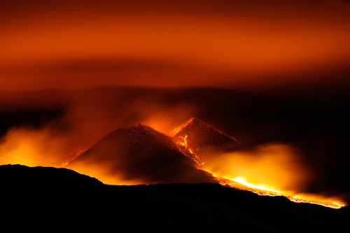 Lava erupts at the New Sud-Est crater of Mt. Etna's volcano, near Catania, in Sicily, southern Italy, early Wednesday, March 6, 2013. According to reports it is the seventh eruption of 2013 and it did not pose any threats to the nearby airport and inhabited areas. (AP Photo/Salvatore Allegra)