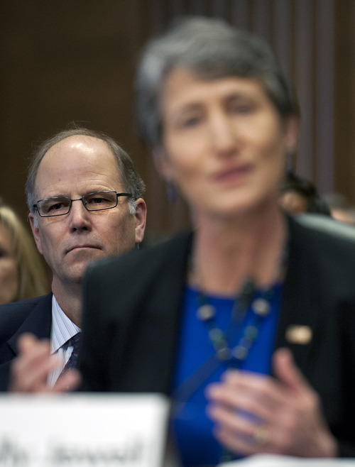 Warren Jewell listens at left as he wife, Interior Secretary nominee Sally Jewell testifies on Capitol Hill in Washington, Thursday, March 7, 2013, before the Senate Energy and Natural Resources Committee hearing on her nomination. (AP Photo/Cliff Owen)