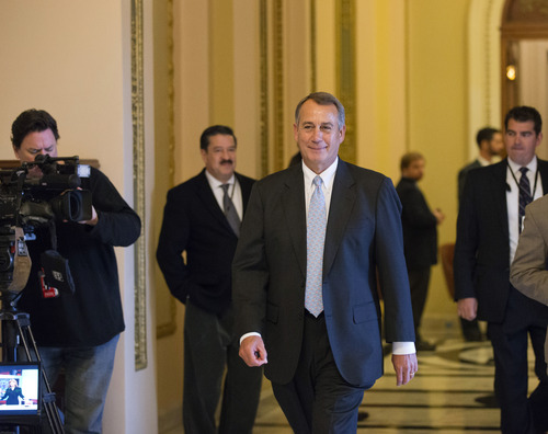 Speaker of the House John Boehner, R-Ohio, leaves the chamber after Republicans passed legislation through the House to ease the impact of $85 billion in short-term cuts and prevent a government shutdown later this month, on Capitol Hill in Washington, Wednesday, March 6, 2013.  (AP Photo/J. Scott Applewhite)