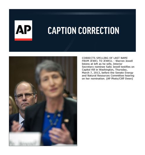 CORRECTS SPELLING OF LAST NAME FROM JEWEL TO JEWELL - Warren Jewell listens at left as he wife, Interior Secretary nominee Sally Jewell testifies on Capitol Hill in Washington, Thursday, March 7, 2013, before the Senate Energy and Natural Resources Committee hearing on her nomination. (AP Photo/Cliff Owen)
