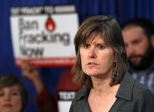 FILE - In this March 26, 2012 file photo, author Sandra Steingraber speaks during a New Yorkers Against Fracking news conference in Albany, N.Y.  As thousands around the country mobilize for and against hydraulic fracturing, industry and some environmental groups in Illinois have come together to draft regulations both sides could live with. Steingraber, an Illinois native and founder of New Yorkers Against Fracking, believes Illinois environmentalists caved in when they should have pushed harder to block fracking. (AP Photo/Mike Groll, File)