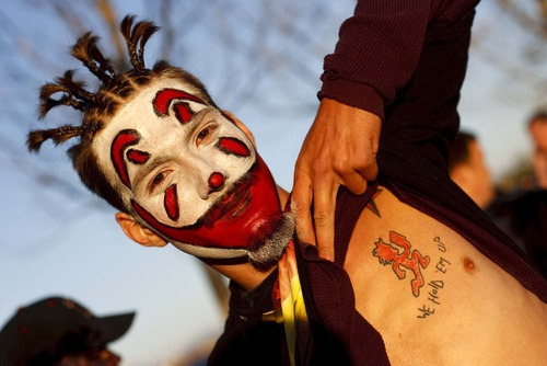 "Trent Nelson  |  The Salt Lake Tribune  Juggalo Keith Joslyn shows off his tattoo of ""Hatchetman"", which serves as the logo for Insane Clown Posse's record label, Psychopathic Records, while waiting in line before the Insane Clown Posse concert at The Great Saltair on Oct. 1, 2009."