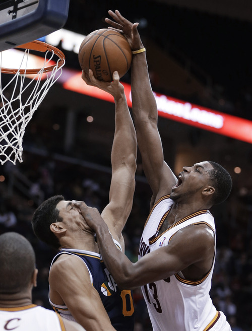 Cleveland Cavaliers' Tristan Thompson, right, jumps toward the basket under pressure from Utah Jazz's Enes Kanter, from Turkey, during the third quarter of an NBA basketball game Wednesday, March 6, 2013, in Cleveland. The Cavaliers won 104-101. (AP Photo/Tony Dejak)