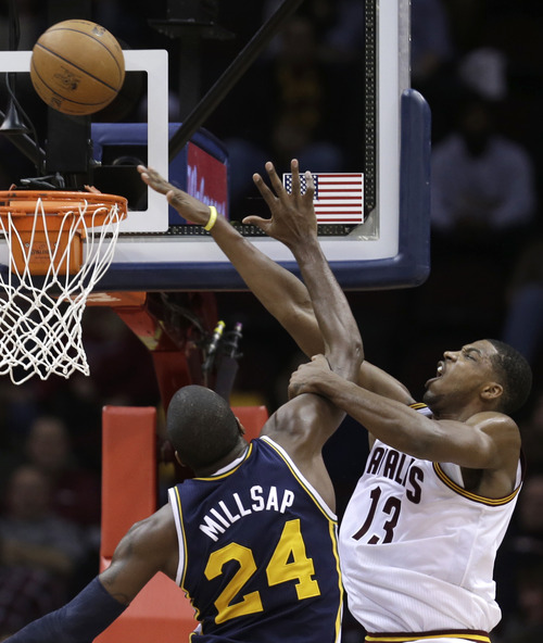 Cleveland Cavaliers' Tristan Thompson (13) works against Utah Jazz's Paul Millsap (24) during the fourth quarter of an NBA basketball game Wednesday, March 6, 2013, in Cleveland. The Cavaliers won 104-101. (AP Photo/Tony Dejak)