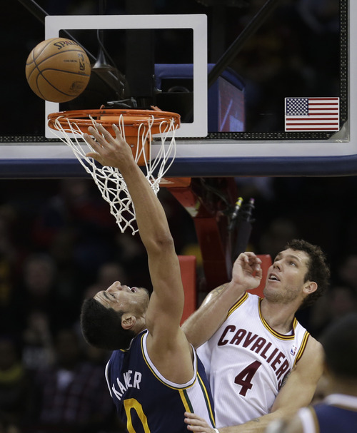 Utah Jazz's Enes Kanter (0), from Turkey, jumps to the basket against Cleveland Cavaliers' Luke Walton (4) during the second quarter of an NBA basketball game Wednesday, March 6, 2013, in Cleveland. (AP Photo/Tony Dejak)