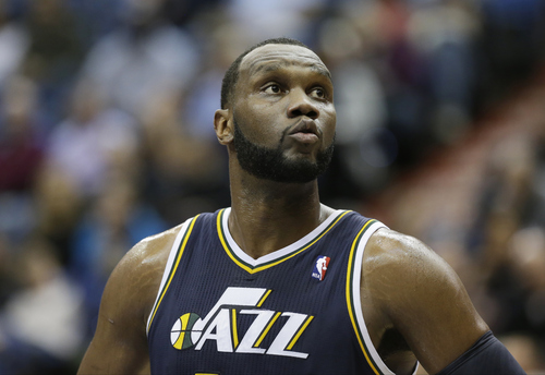 Utah Jazz's Al Jefferson is shown in the first quarter of an NBA basketball game against the Minnesota Timberwolves Wednesday, Feb. 13, 2013 in Minneapolis. (AP Photo/Jim Mone)