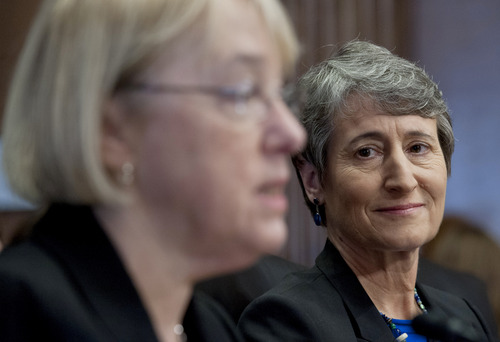 Interior Secretary nominee Sally Jewell listens at right as Sen. Patty Murray, D-Wash. introduces her on Capitol Hill in Washington, Thursday, March 7, 2013, during Jewell's nomination hearing before the Senate Energy and Natural Resources Committee. (AP Photo/Cliff Owen)