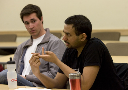 Kim Raff  |  The Salt Lake Tribune (from left) Chris Gibbs and Pratik Raghu, members of the Westminster Mock Trial team who have recently beat out several top schools, prepare for a national event at Westminster College in Salt Lake City on March 3, 2013.