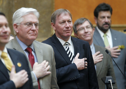 Al Hartmann  |  The Salt Lake Tribune Rep. Stewart Barlow, R-Fruit Heights, center, pledges allegiance to the flag on the floor of the Utah House of Representatives with his fellow legislators. He is a physician and penned a resolution about decreasing obesity in Utah.
