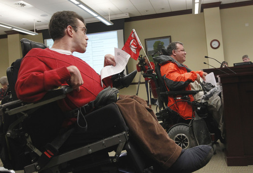 Al Hartmann  |  The Salt Lake Tribune Andrew Riggle, advocate for the Disability Law Center, left, waits in line to testify after Louis Fazio, an advocate for the Coalition for People with Disabilities, at a Social Services Appropriations hearing Friday. The committee was hearing testimony on whether to expand the low-income health program Medicaid.