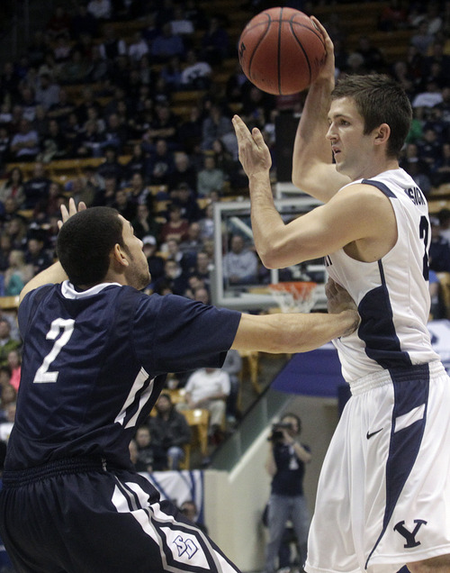 BYU's Craig Cusick looks to pass the ball against San Diego during an NCAA college basketball game in Provo, Utah on Saturday, Jan. 19, 2013. (AP Photo/The Daily Herald, James Roh)