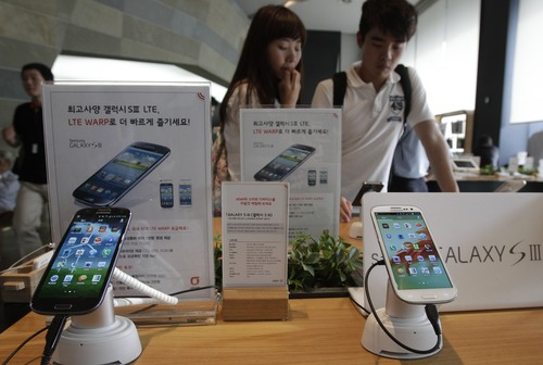 (AP Photo/Ahn Young-joon) The Samsung Galaxy S III, which outsold the initial sales of the iPhone 5, has been the biggest-selling Android phone on the market. The Samsung Galaxy S IV is expected to be announced on March 14 in New York City.