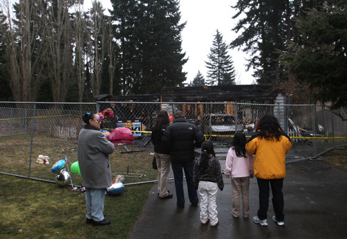 Rick Egan  | The Salt Lake Tribune   People stop to pay their respects at the home where Josh Powell took his life and the lives of Charlie and Braden, in Graham, Wash., Wednesday, February 8, 2012.