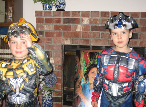 Braden Powell, left, and Charlie Powell are dressed as Transformers in a family photo from Halloween. Courtesy of the Cox family