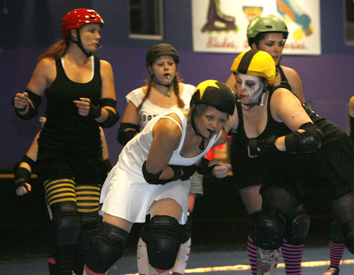 Leah Hogsten  |  The Salt Lake Tribune  Members of the Salt City Derby Girls roller derby team is seen in this 2006 file photo. On March 9, 2013, The Wasatch Roller Derby League and Camp Hobe will hold the Skater Smackdown, a match between the women's roller derby teams, Hot Wheelers and Salt Flat Fallout.