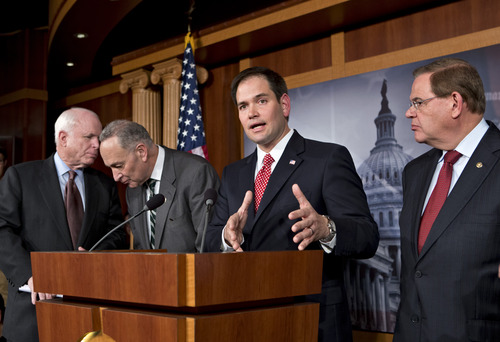 "FILE – In this Jan. 28, 2013, file photo Sen. Marco Rubio, R-Fla., center,speaks at a Capitol Hill news conference with a bipartisan group of leading senators to announce their agreement on the principles of sweeping legislation to rewrite the nation's immigration laws. Eight senators meet in private several times a week, alternating between, from left, Sen. John McCain's, R-Ariz., and Sen. Charles Schumer's, D-N.Y., offices, and in a capital riven by partisanship and gridlock, they are determined to be the exception and actually get something done. This is immigration reform's "" Gang of Eight"".  At right is Sen. Robert Menendez, D-N.J., The group includes Sen.s Lindsey Graham, R–S.C., Dick Durbin, D-Ill., Jeff Flake, R-Ariz., and Michael Bennet, D-Colo., not shown here. (AP Photo/J. Scott Applewhite)"