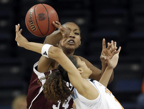 Texas A&M center Karla Gilbert (34) and Tennessee guard Meighan Simmons (10) vie for a rebound during the first half of an NCAA college basketball game in the Southeastern Conference women's tournament, Saturday, March 9, 2013, in Duluth, Ga. (AP Photo/John Bazemore)